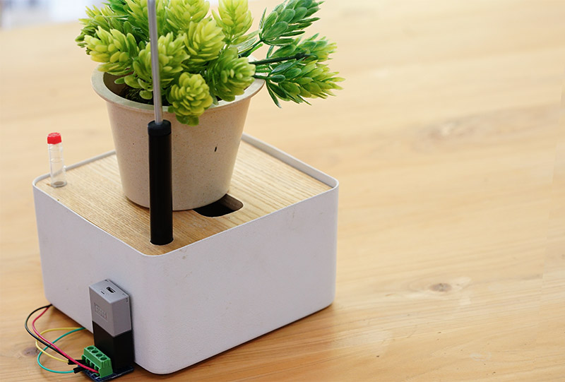Self-watering plant stand